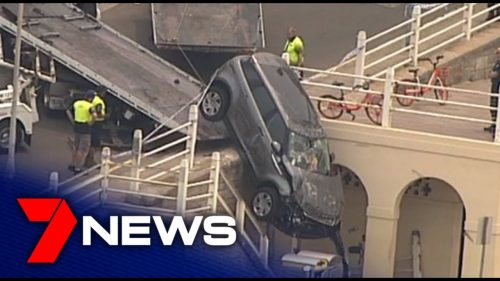 Out-of-control-Range-Rover-crashes-over-Bondi-Beach-guardrail-7NEWS